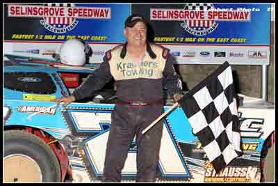 Scott Haus celebrating in victory lane at Selinsgrove Speedway